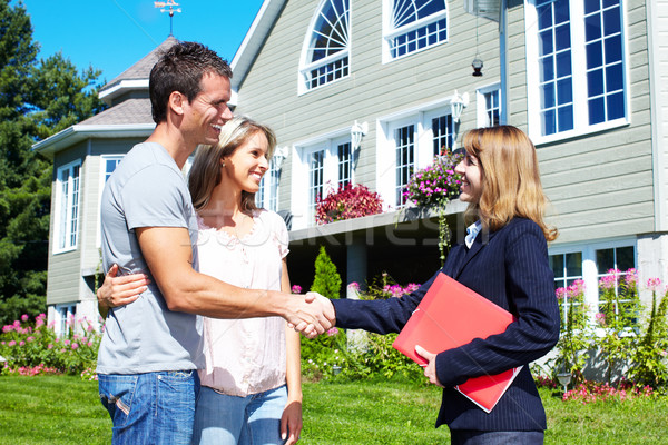Stock photo: Happy family near new house.