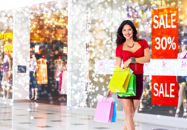 Young woman with shopping bags. Stock photo © Kurhan