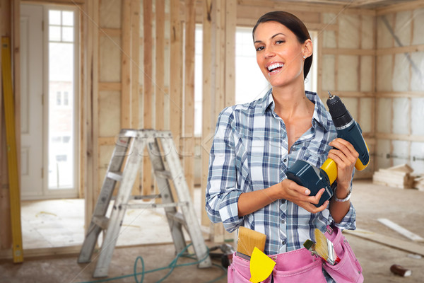 Young woman with a drill. Stock photo © Kurhan