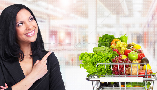 Asian woman with Grocery shopping cart. Stock photo © Kurhan