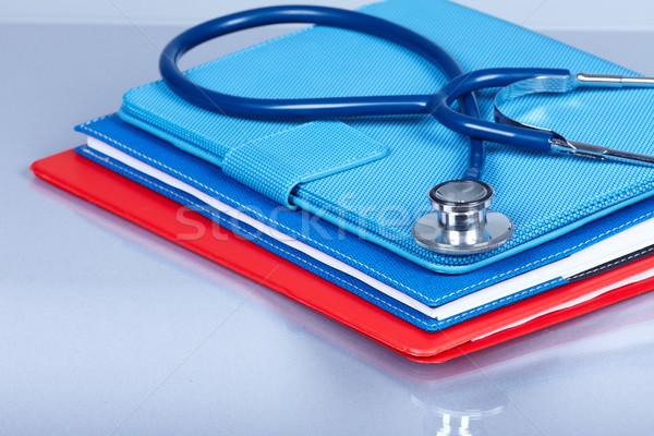 Stockfoto: Medische · stethoscoop · gezondheidszorg · dienst · boek · achtergrond