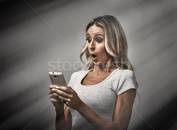 Girl with smartphone. Stock photo © Kurhan