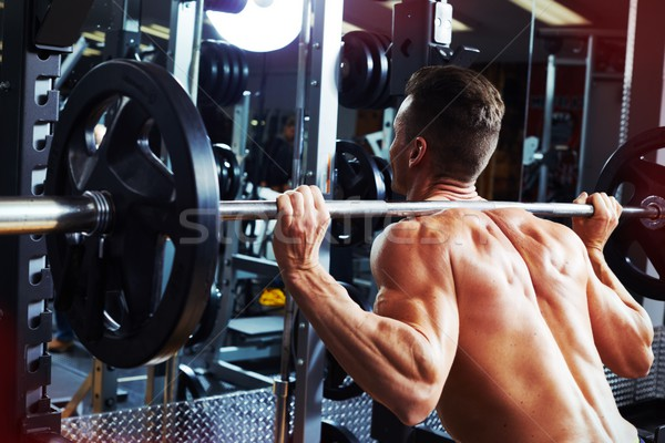 Man squat with barbell Stock photo © Kurhan