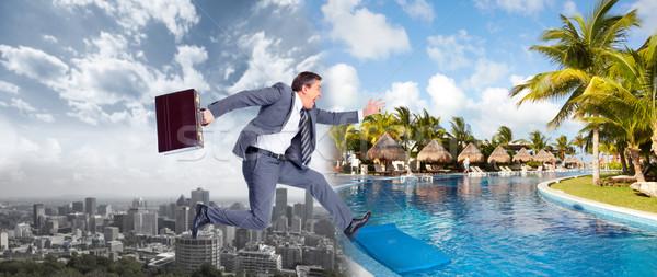 Empresário saltando água corrida praia férias de verão Foto stock © Kurhan