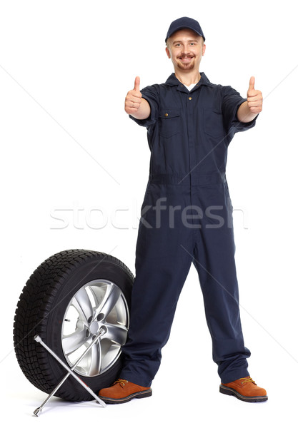 Car mechanic with a tire wrench. Stock photo © Kurhan