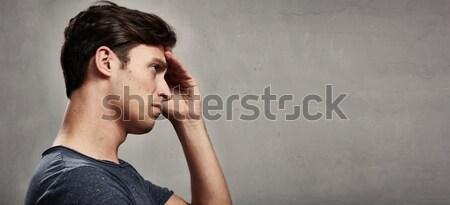 Dor de cabeça deprimido homem cinza parede cara Foto stock © Kurhan