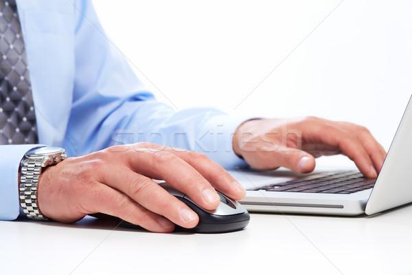 Hands of businessman with laptop. Stock photo © Kurhan