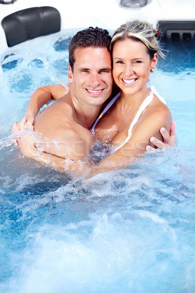 Feliz casal banheira de hidromassagem relaxante férias menina Foto stock © Kurhan
