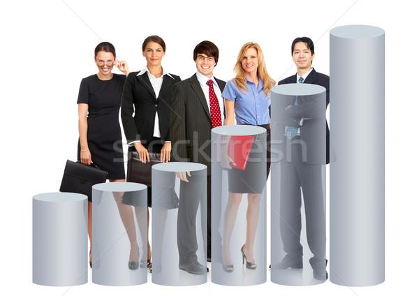 Zakenlieden team grafiek geïsoleerd witte glimlach Stockfoto © Kurhan