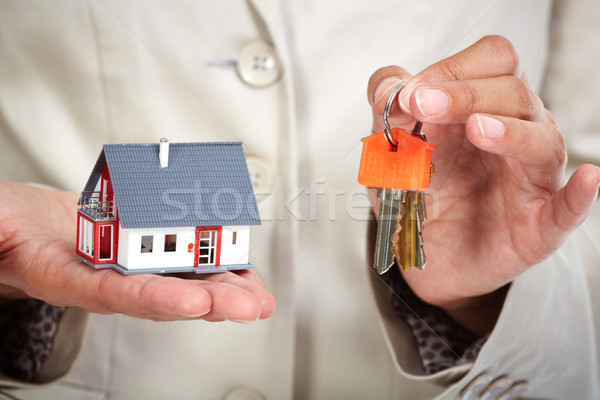 Woman Hands with little house and key. Stock photo © Kurhan