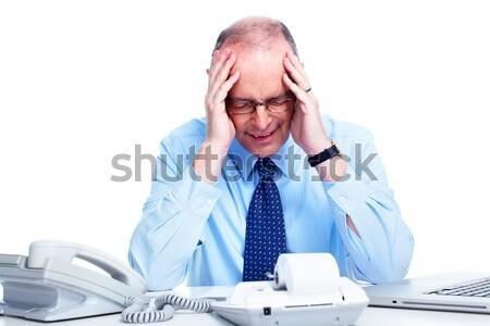 Empresário dor de cabeça cansado homem de negócios enxaqueca escritório Foto stock © Kurhan