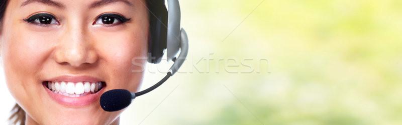 Secretary with headphones Stock photo © Kurhan