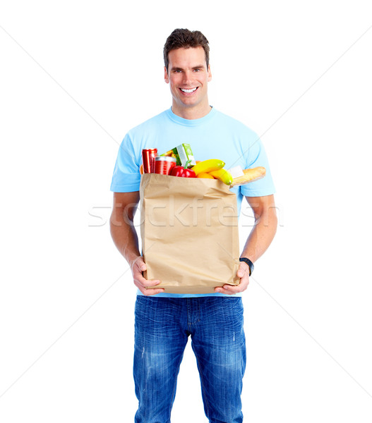 Young man with a grocery shopping bag. Stock photo © Kurhan