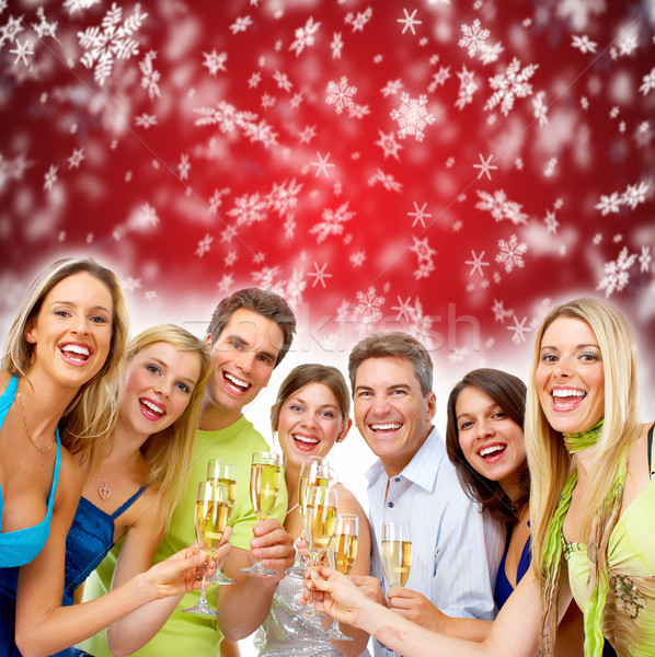 Happy Christmas people drinking champagne Stock photo © Kurhan
