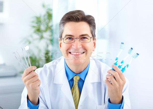 Dentysta uśmiechnięty uśmiech szczęśliwy zdrowia tle Zdjęcia stock © Kurhan