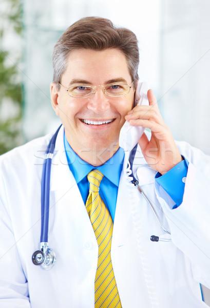 Medico medici chiamando telefono ufficio business Foto d'archivio © Kurhan