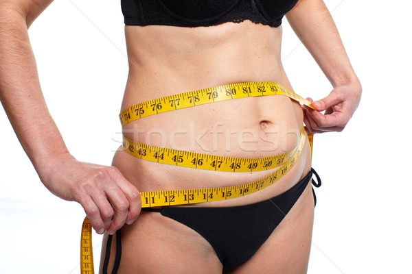 Mulher gordura abdômen excesso de peso Foto stock © Kurhan