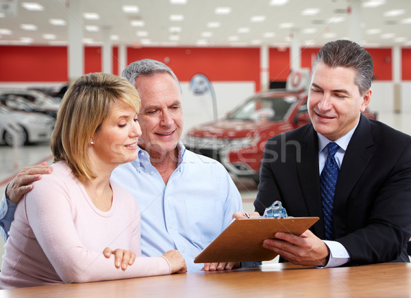 Senior couple with a car dealer. Stock photo © Kurhan