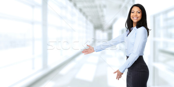 Asian business woman inviting in the office. Stock photo © Kurhan