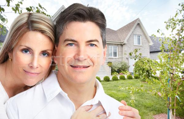 Happy couple near new house. Stock photo © Kurhan