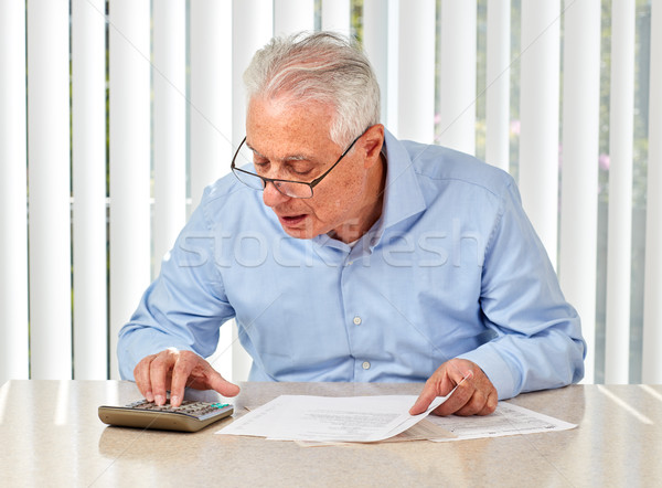 Elderly man with papers. Stock photo © Kurhan