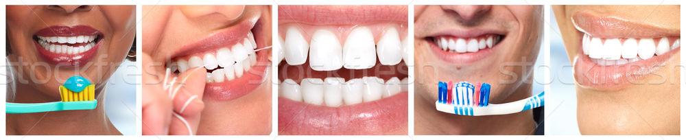 Teeth with toothbrush. Stock photo © Kurhan