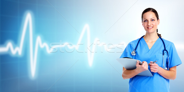 Medical doctor woman. Over cardio background. Stock photo © Kurhan