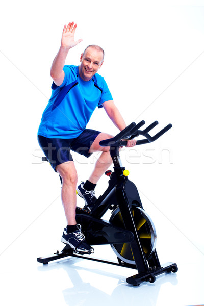 Fitness uomo bike isolato bianco sfondo Foto d'archivio © Kurhan