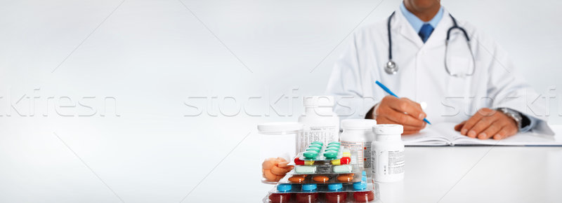 Doctor writing medical prescription. Stock photo © Kurhan