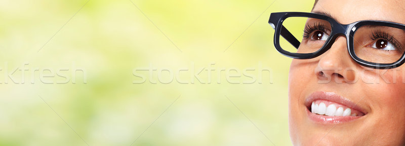 Beautiful woman eyes with eyeglasses. Stock photo © Kurhan