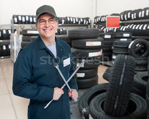 Car mechanic with tire wrench. Stock photo © Kurhan