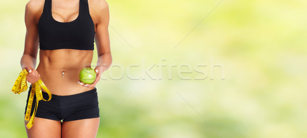 Woman abdomen with measuring tape and apple. Stock photo © Kurhan