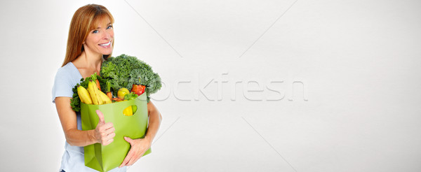 Woman with Grocery shopping bag. Stock photo © Kurhan