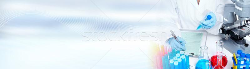 Doctor woman with microscope Stock photo © Kurhan