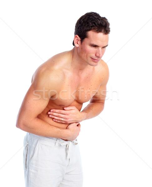 Man having stomach pain. Stock photo © Kurhan