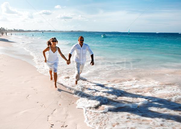 Couple running on the beach Stock photo © Kurhan