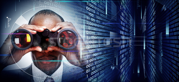 Man with binoculars on techno background Stock photo © Kurhan