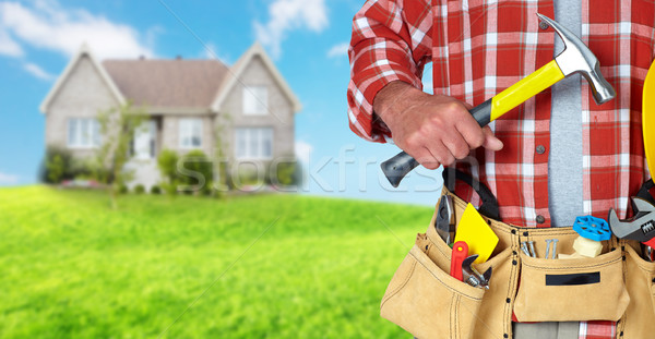 Hand of worker with a hammer. Stock photo © Kurhan
