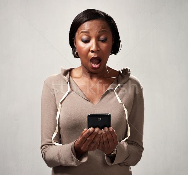 African american woman with smartphone Stock photo © Kurhan