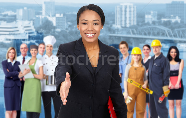Business woman and Group of industrial workers. Stock photo © Kurhan