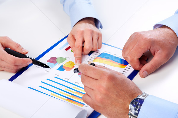 Hands of business people with chart. Stock photo © Kurhan