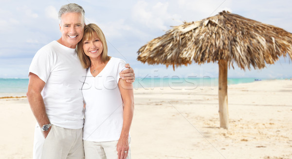Happy senior couple on caribbean beach. Stock photo © Kurhan