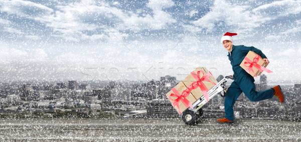 работает доставки почтальон счастливым Рождества представляет Сток-фото © Kurhan