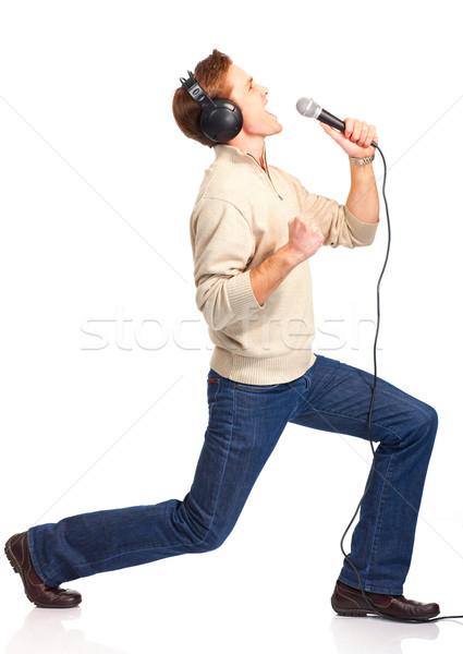 Szczęśliwy karaoke odizolowany biały strony człowiek Zdjęcia stock © Kurhan
