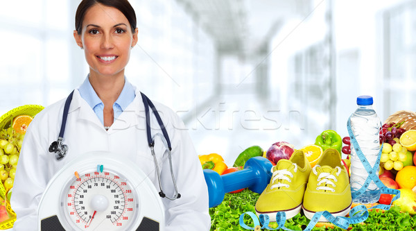 Doctor woman with scales. Stock photo © Kurhan