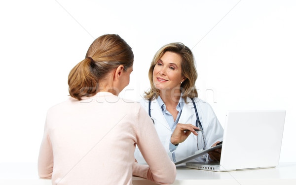 Mature medical doctor woman and patient. Stock photo © Kurhan