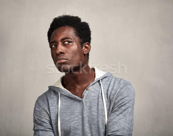 Gondolkodik afroamerikai férfi afroamerikai fiatalember szürke fal Stock fotó © Kurhan