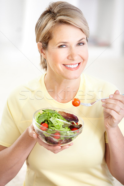Zöldségek gyümölcsök érett mosolygó nő nő étel Stock fotó © Kurhan