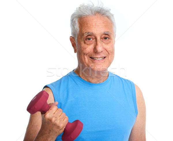 Senior man with dumbbell. Stock photo © Kurhan