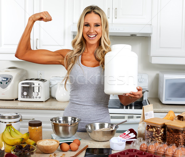 Happy girl with protein jar. Stock photo © Kurhan